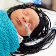 Infant asleep while having an optical-EEG scan