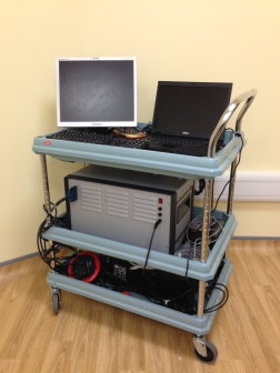 The combined DOI-EEG system is portable on a trolley and can be moved to the cot-side for infant scanning